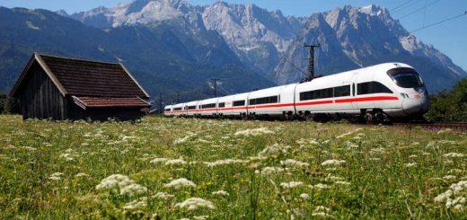 ICE T der Baureihe 411 bei Garmisch-Partenkirchen vor einer pächtigen Bergkulisse in den Alpen.